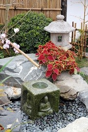Backyard Japanese Garden with Stone Lantern and Water Fountain