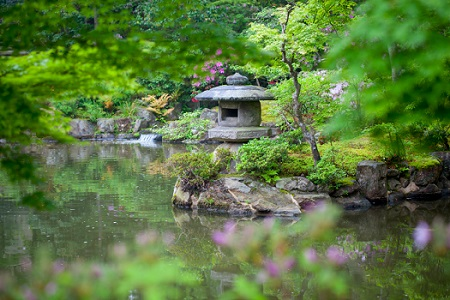 Stone lantern in a Japanese garden on a rainy day